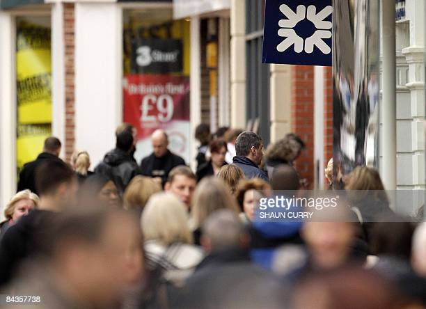 Shoppers walk past a Royal Bank of Scotland branch in Chelmsford in Essex on January 19 2009 Britain unveiled a second bank rescue package worth tens...