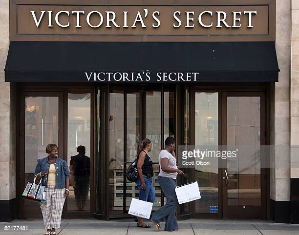 Shoppers walk past a Victoria's Secret store in the Lincoln Park neighborhood August 4 2008 in Chicago Illinois Consumer prices jumped in June at the...