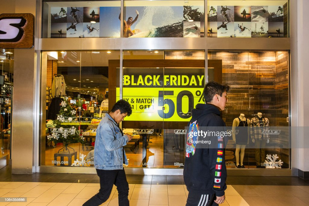 Shoppers Walk Past An Advertisement For Black Friday Sales Displayed News Photo Getty Images