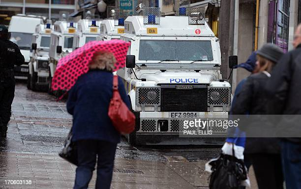 b5fae37882 Shoppers walk past armoured police vehicles liningup in the streets of the city  centre in Belfast