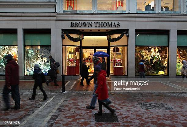 Shoppers walk past Brown Thomas department store on Grafton Street on December 1 2010 in Dublin Ireland The Irish economy has faltered after years of...