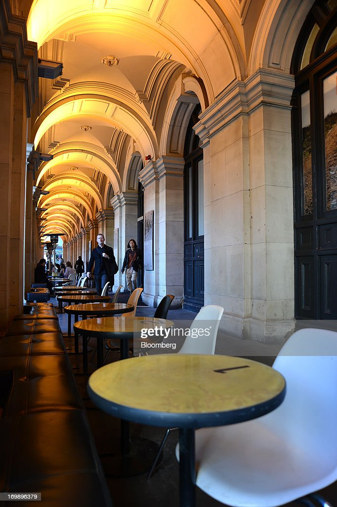 Shoppers walk past empty chairs at a cafe in the arcade of the GPO building in Melbourne, Australia, on Sunday, June 2, 2013. The Australian Bureau of Statistics is scheduled to release first-quarter gross domestic product data on June 5. Photographer: Carla Gottgens/Bloomberg via Getty Images