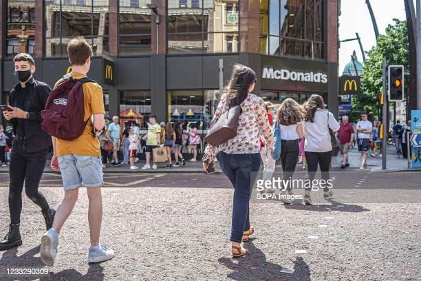 Shoppers walk past McDonald's restaurant on High Street in Belfast.