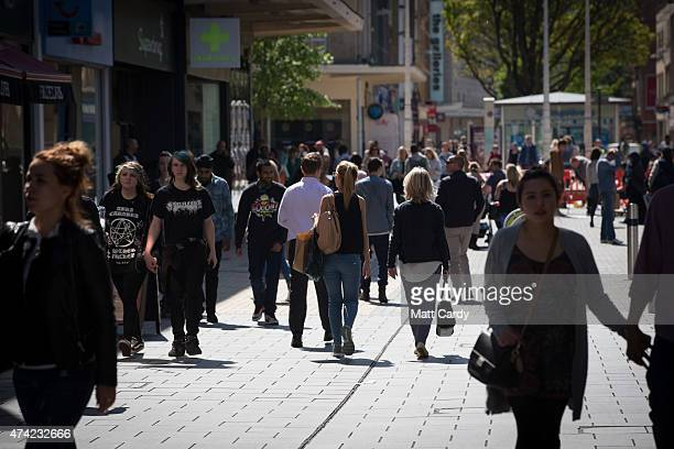 Shoppers walk past shops on the main shopping street in Broadmead on May 21 2015 in Bristol England According to figures released by the Office for...