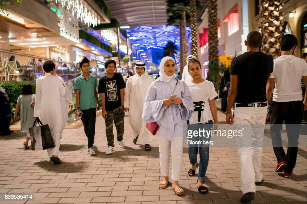 Shoppers walk past stores and restaurants in Avenues shopping mall in Kuwait City Kuwait on Sunday Aug 13 2017 Kuwait will issue a tender to build...