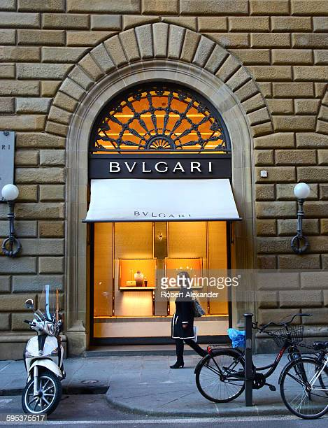 Shoppers walk past the Bulgari store on Via Tornabuoni in Florence, Italy. Bulgari is an upscale retailer of Italian jewelry, watches, accessories...