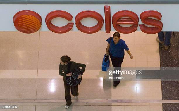 Shoppers walk past the entrance of a Coles Group Ltd supermarket in Sydney Australia on Wednesday May 16 2007 Coles Group Ltd targeted for a takeover...