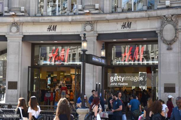 Shoppers walk past the HM fashion retail shop entrance on Oxford Street Oxford Circus on June 11 2018 in London England