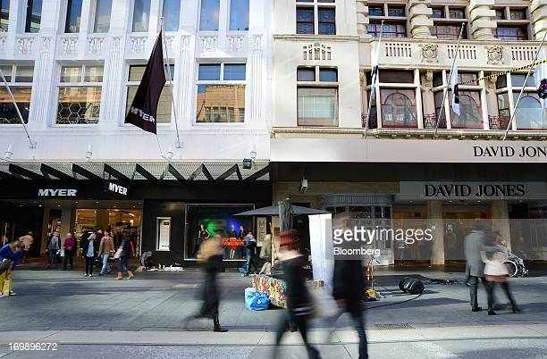 Shoppers walk past the Myer Holdings Ltd and David Jones Ltd department stores on Bourke Street Mall in central Melbourne Australia on Sunday June 2...