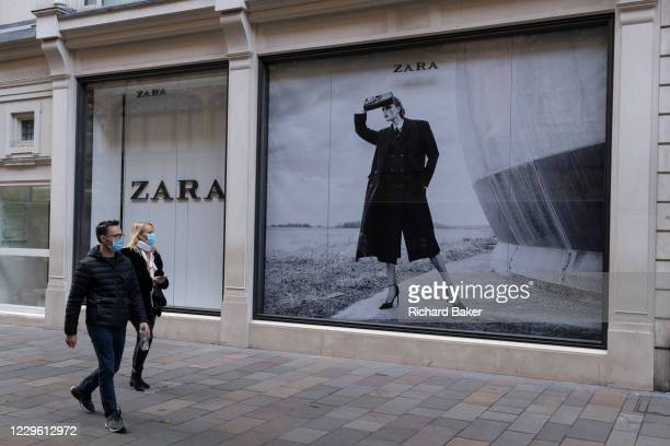 Shoppers walk past the Zara retailer in Knightsbridge during the second Coronavirus lockdow when most non-essential retailers and small businesses...