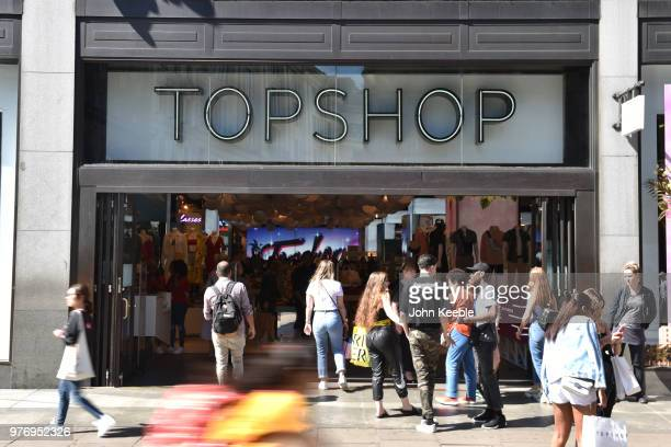 Shoppers walk past Topshop fashion retail shop on Oxford Street on June 11, 2018 in London, England.