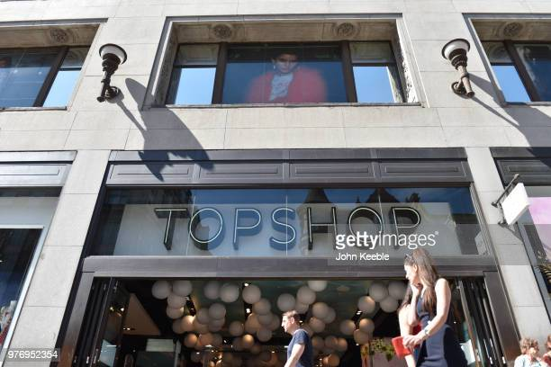 Shoppers walk past Topshop fashion retail shop on Oxford Street on June 11 2018 in London England