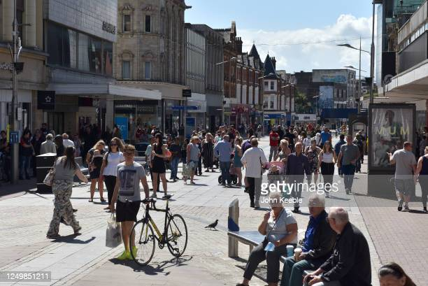 Shoppers walk the high street on June 15 2020 in SouthendonSea United Kingdom The British government have relaxed coronavirus lockdown laws...