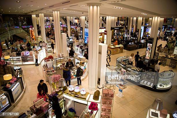 Shoppers walk through a Macy's Inc department store in New York US on Monday Feb 22 2016 Macy's Inc the largest US departmentstore company is...