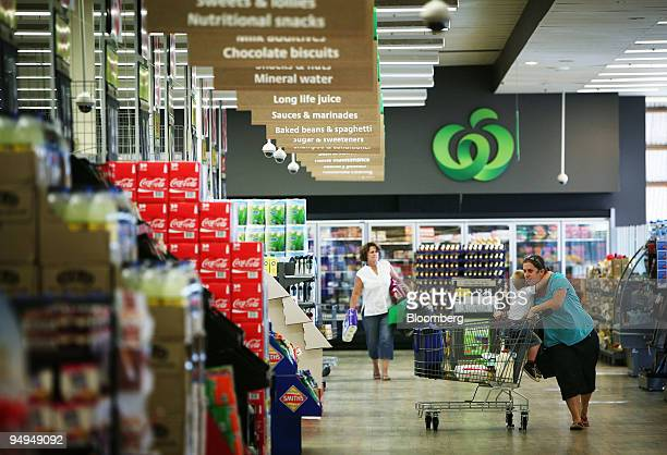 Shoppers walk through a Woolworths Ltd supermarket in Sydney Australia on Friday Feb 27 2009 Woolworths Ltd Australia's biggest retailer fell the...