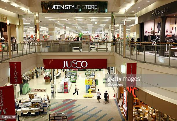 Shoppers walk through an Aeon Co shopping center in Toda City Saitama Prefecture Japan on Monday July 6 2009 Aeon Co is expected announce earnings...