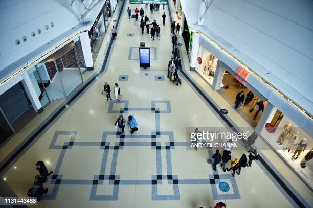 Shoppers walk through bridges shopping centre in Sunderland in north east England on March 16 2019 The former shipbuilding city in northeast England...