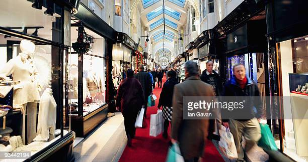 Shoppers walk through Burlington Arcade past the Christmas themed window displays in Piccadilly on November 26 2009 in London England