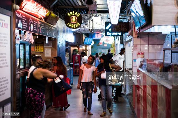 Shoppers walk through DeKalb Market Hall at City Point in the Brooklyn borough of New York US on Tuesday July 18 2017 Bloomberg is scheduled to...