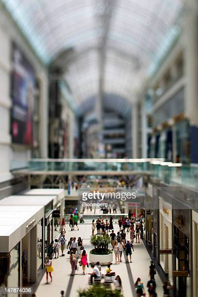 Shoppers walk through Eaton Centre in this photo taken with a tilt shift lens in Toronto Ontario Canada on Wednesday July 4 2012 Canada's economy the...