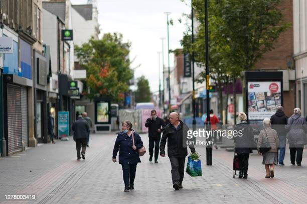 Shoppers walk through Middlesbrough following criticism of lockdown measures by the Middlesbrough mayor Andy Preston on October 02, 2020 in...