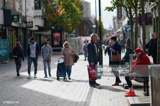 Shoppers walk through Middlesbrough town centre on October 02, 2020 in Middlesbrough, England. The mayor of Middlesbrough, Andy Preston is leading a...