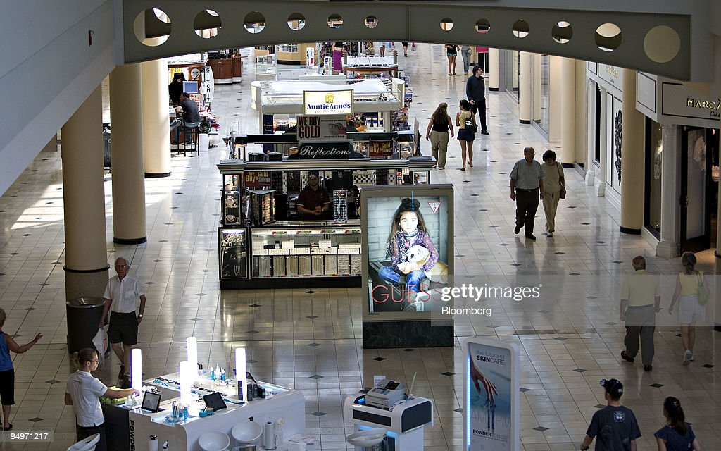 Shoppers walk through Roosevelt Field Mall in Garden City, New York