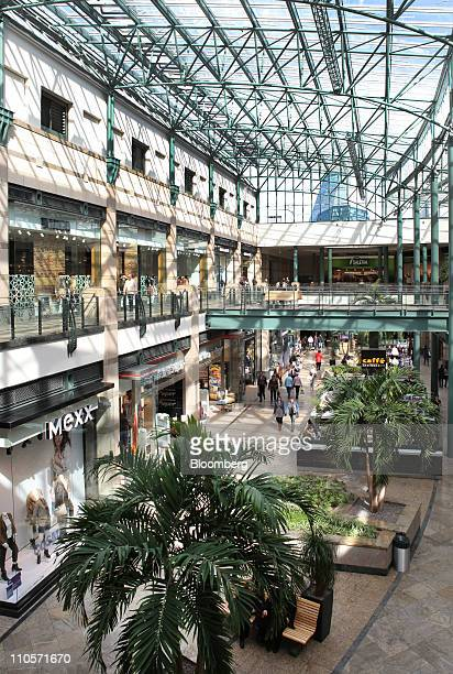 Shoppers walk through the CentrO retail complex in Oberhausen Germany on Monday March 21 2011 German retail sales rose for a second month in January...