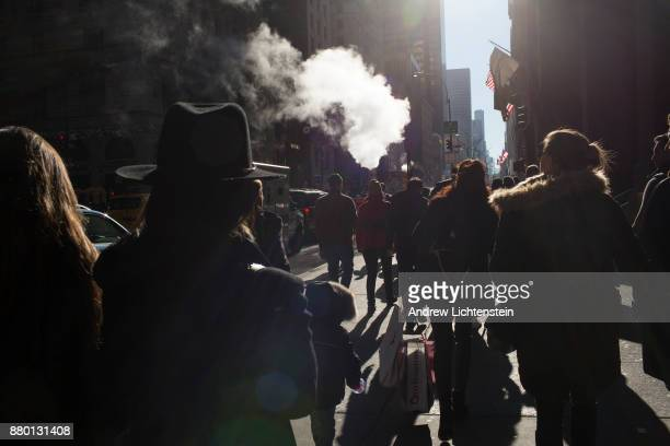 Shoppers walk through the crowded streets of midtown on Black Friday November 24 2017 in New York City