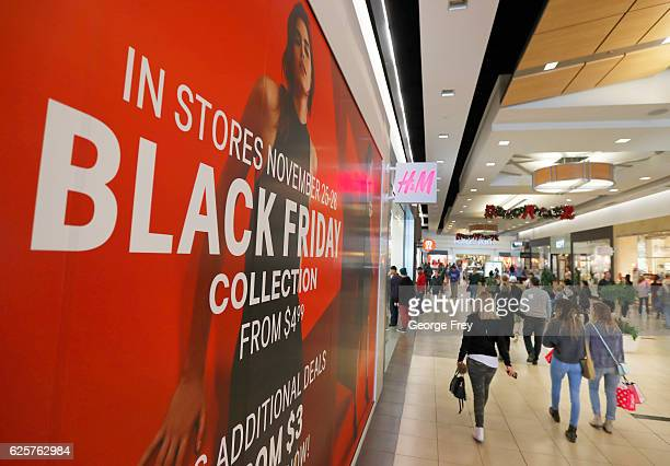 Shoppers walk through the Fashion Place Mall looking for 'Black Friday' deals on November 25 2016 in Salt Lake City Utah The day after Thanksgiving...