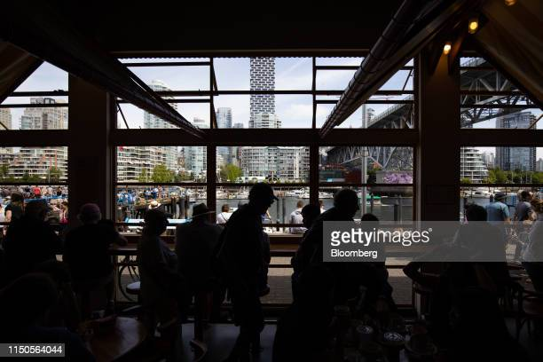 Shoppers walk through the Granville Island Public Market in Vancouver British Columbia Canada on Sunday June 2 2019 Statistics Canada is scheduled to...