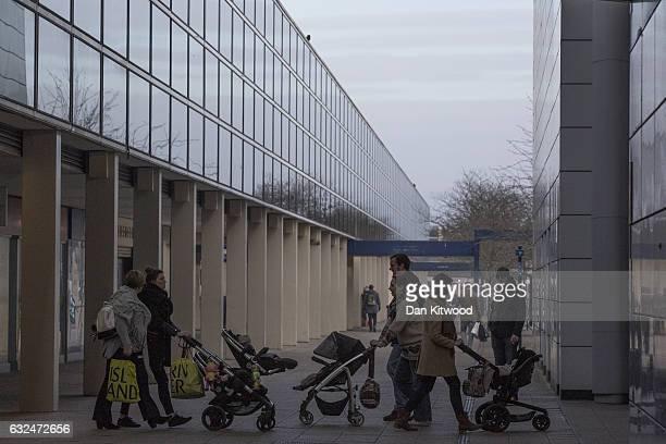 Shoppers walk through the 'Intu' Shopping Centre on January 23, 2017 in Milton Keynes, England. Milton Keynes in Buckinghamshire marks the 50th...