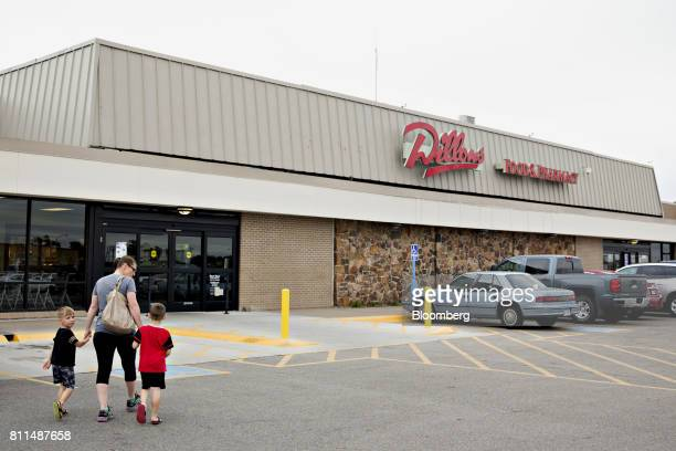 Shoppers walk to a Dillons Food Stores supermarket owned by Kroger Co in Hays Kansas US on Thursday June 29 2017 Kroger remains committed to its...