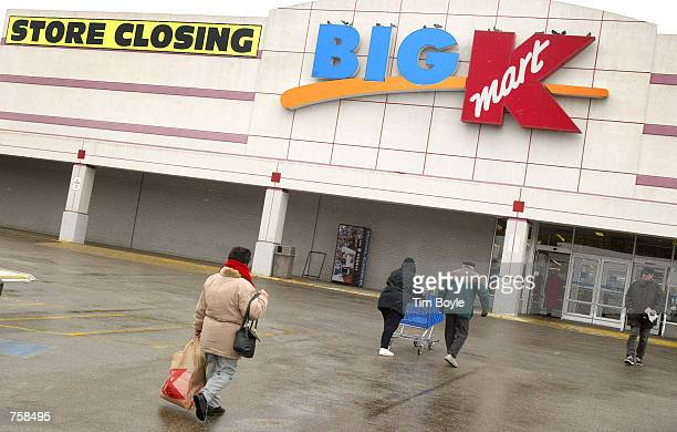 Shoppers walk to and from the entrance of a Kmart store March 25 2002 that is scheduled for closing in Wheeling IL US bankruptcy Judge Susan Pierson...