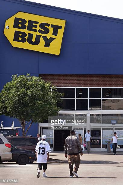 Shoppers walk toward a Best Buy store in the Lincoln Park neighborhood August 4 2008 in Chicago Illinois Consumer prices jumped in June at the...