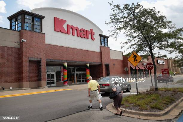 Shoppers walk toward a Kmart store on August 24 2017 in Elmhurst Illinois Sears Holdings Corporation the owner of Kmart said today it was planning on...