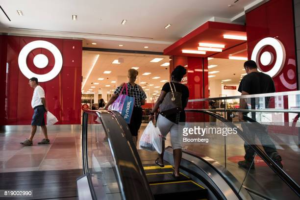 Shoppers walk towards a Target Corp store at City Point in the Brooklyn borough of New York US on Wednesday July 19 2017 Bloomberg is scheduled to...