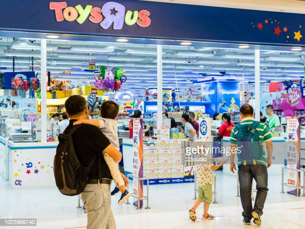 Shoppers walk towards to a Toys R US retail store at the Harbour City on August 23 2018 in Hong Kong, Hong Kong