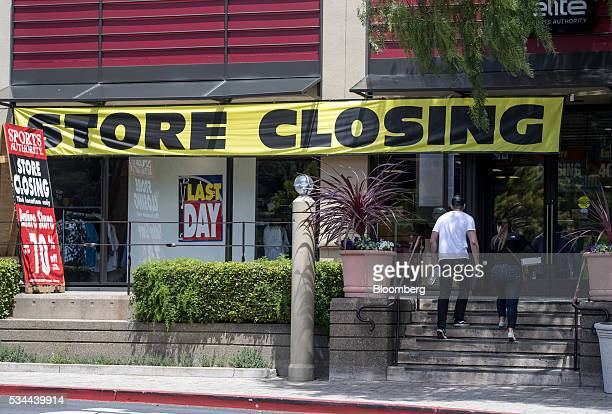 Shoppers walk up steps to enter a Sports Authority Inc store in Corte Madera California US on Tuesday May 24 2016 A judge overseeing the chain's...