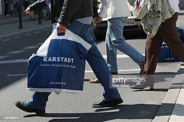 Shoppers walk with Karstadt department store shopping bags in Steglitz district on July 17 2012 in Berlin Germany Karstadt management recently...