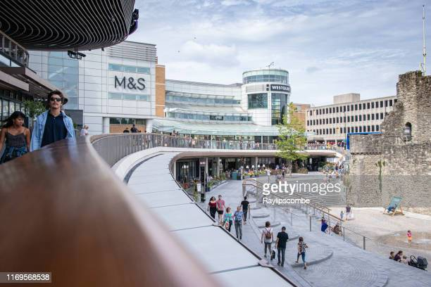 shoppers walking around westquay shopping centre in southampton hampshire, uk. it is located in the middle of southampton city centre, and has 90 stores spread over three levels. - southampton england stock pictures, royalty-free photos & images