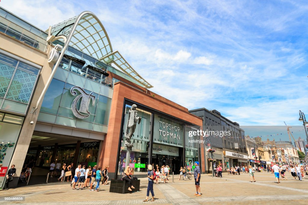 Shoppers walking by the Trinity shopping centre in Leeds : Stock Photo