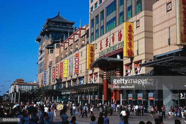 Shoppers Walking Down a Busy Shopping Promenade
