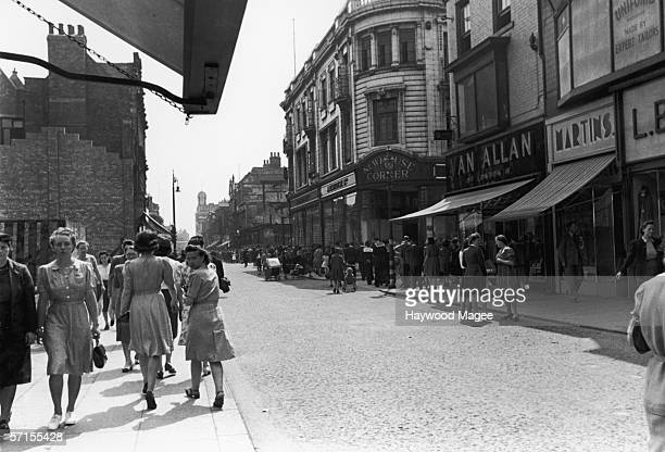 Shoppers walking down a street in Middlesborough 11th August 1945 Original Publication Picture Post 2062 Middlesborough The Plan Matures pub 1945
