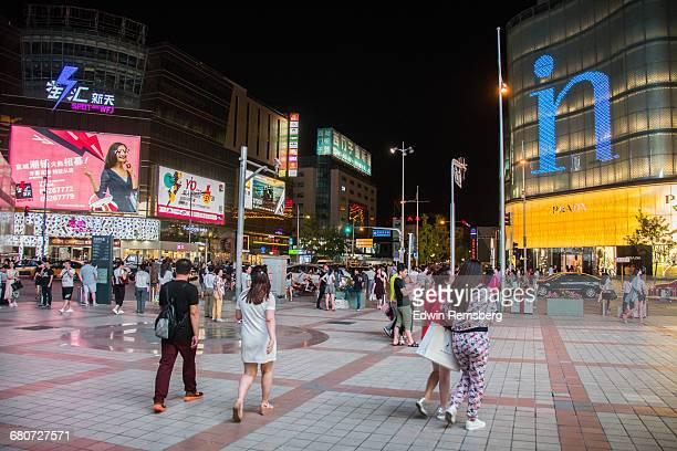 Shoppers walking through Wangfujing Street