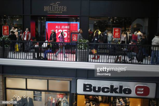Shoppers was past a Hollister Co store at the Easton Town Center Mall in Columbus Ohio US on Tuesday Dec 26 2017 Americans displayed their buying...