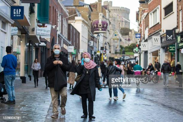 Shoppers wear face coverings and gloves to help prevent the spread of the coronavirus on 10 October 2020 in Windsor, United Kingdom. The Royal...