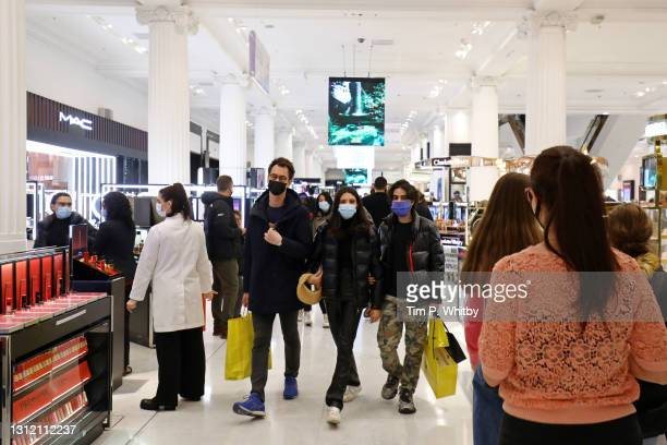 Shoppers wear face coverings as they look around Selfridges store on Oxford Street on April 12, 2021 in London, England. England has taken a...