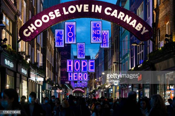 Shoppers wear face masks as they walk in Carnaby Street, ahead of the new Tier-4 restriction measures, on December 19, 2020 in London, England....