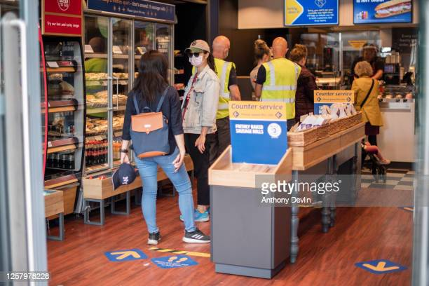 Shoppers wear face masks in a Greggs bakery on July 24, 2020 in Manchester, England. From today, consumers in the United Kingdom must wear face...